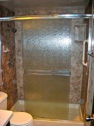 After: Shower w/River Rock walls & doors w/Rain glass.