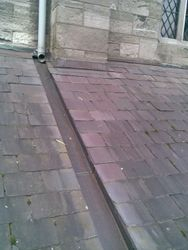 Copper run off gutter on slate roof