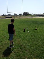 Kyler kicking a field goal.