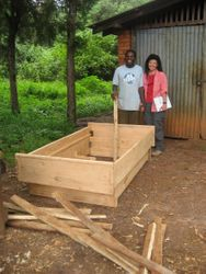 Mimi with a village member and carpenter