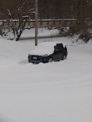 """Church Parking lot with Marie's stuck car in almost 16"""" of snow."""