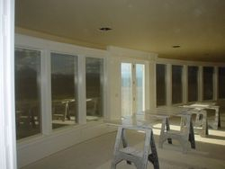 Painted window wall trim with sills and panels below