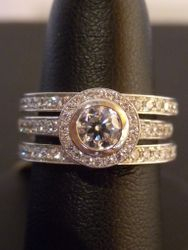 18ct/platinum engagement ring and double wedding ring