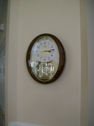 SMALL WORLD CHIMING WALL CLOCK