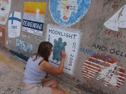 Our painting on the harbour wall in Porto Santo