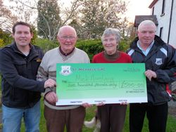 Mick Armstrong receives his Cheque