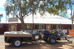 Tom's Trike & trailer in front of the Toompine Hotel