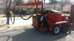 NuCoat Sealing, LLC:  Crack sealing your neighborhood streets.