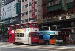 Car #25 and a New World First Bus on Hennessy Road.
