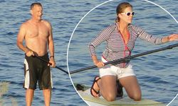 with Tom Hanks canoeing in Naxos waters in marine colors