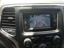 Rydeen Mobile backup camera integrated to the factory radio on this 2014 Jeep Grand Cherokee