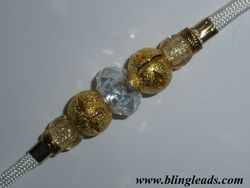 Gold stardust and clear faceted design.
