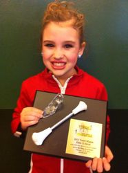 Erienne and her Elite X-Strut 1st place award