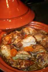 moroccoan Cuisine. Chicken Tagine with Apricot and Almonds.
