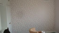 pink flowery wallpaper in bedroom feature wall