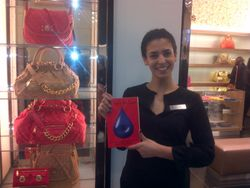 Customre holding a copy of This Can't Be Love inside Bloomingdales in Manhattan, NY.