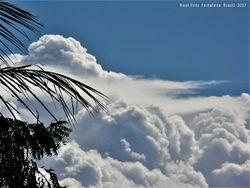 Cumulus congestus and cirrus clouds.
