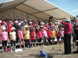 Sue Johnson Choir Director with several Festival Choirs