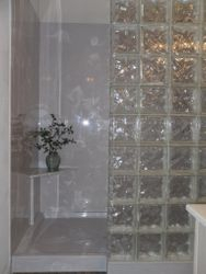 Cultured marble shower with glass block