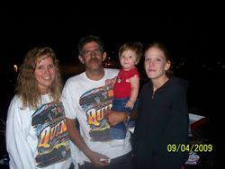 Jim, his wife Tina, daughter Carrie, and grandbaby Haley.
