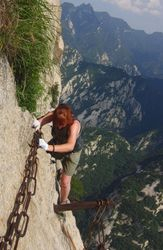 Me climbing Hua Shan - One of the scariest and most exhilarating moments of my life!