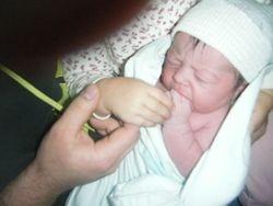 Rebecca holding new sister!