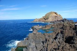 """Rocks with a natural """"swimming pool"""" in the middle (a giant rock pool!)"""