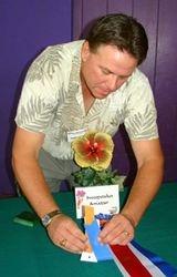 Mark Gore adjusting ribbon on head table