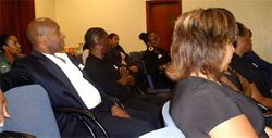 Delegates listen intently