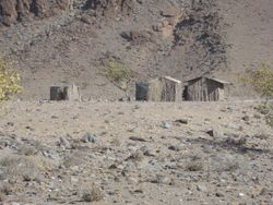 more himba huts scattered along the way