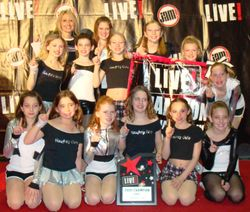 Dance Champions with awards.