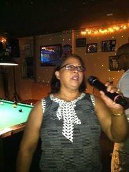 Leonne having fun doin' it up at 502 Bar Lounge's Social Saturday Night Karaoke.