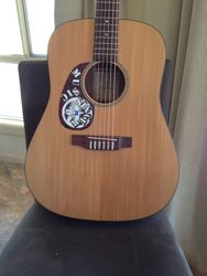 My Martin Acoustic - 15 years old at least.