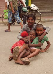7 Shivani, 10, who begs in Lajpat Nagar market, New Delhi, with two of her cousins.  They say they're happy, have no problems, and they like to play