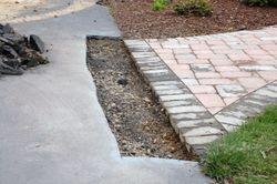 Sawcut asphalt near walkway