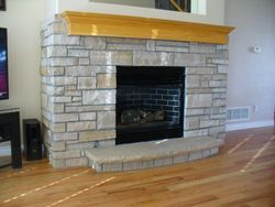 Buff strip thinstone veneer on small fireplace