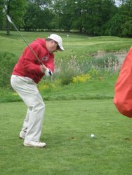 Brother Pete Seliga tees it up