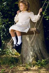 Josie as a child on the swing