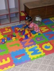 Baby Genius building with blocks
