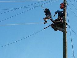 Matt Whisenant leaps off  zip line platform