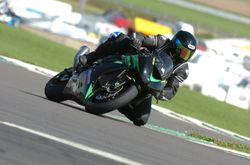 Eric Innes with knee down on his '08 ZX10