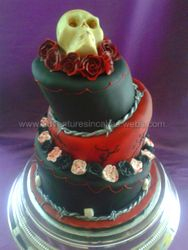 Red and Black Wedding Cake with Chocolate Skull