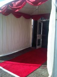 Entrance Marquee Ivory lined with red swags and red carpet