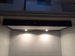 Wall Mounted range-hood mounted within stove hobo