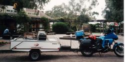 Tom's K75RT & Camper Trailer at the Dog on The Tucker Box just north of Gundagai NSW on the way to 1996 AGM Hobart - Feb 1996