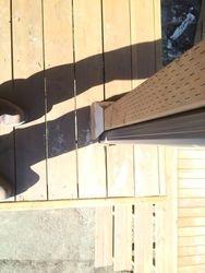 Gutter downspout through the deck