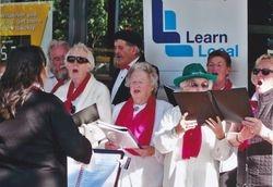 Choir singing carols in the street