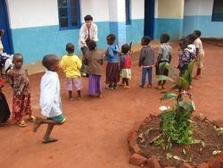 Mimi with children at the Kindergarten