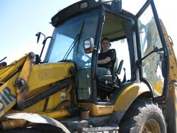 Mary-Ann behind the wheel of a JCB