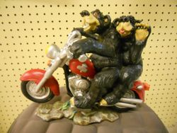 Rick Rowley Art Ursine Couple on Bike Wood Carving